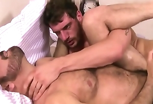 Two bearded bodies fucking with passion