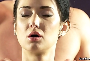 Dark haired babe fucks masseur on table