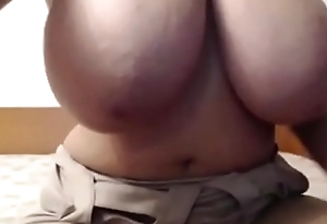 Prominent tits grabs and squeezes tease