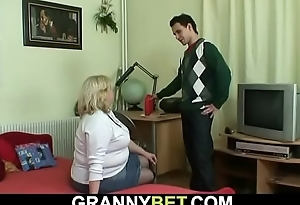Grandma with renowned boobs rides his young cock