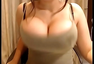 Milf showing big round tits with milk on cam