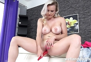 Blonde MILF actively toys bald snatch essentially the couch