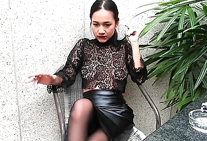 Young girl smokes topless with the addition of in leather skirt